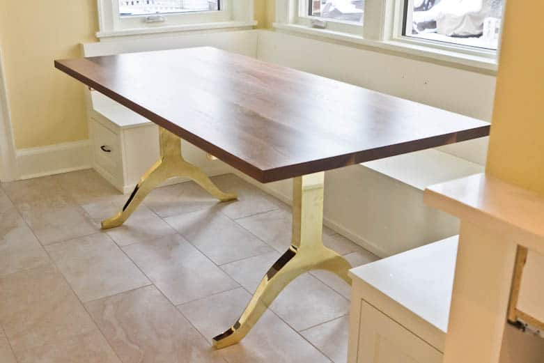 WALNUT TABLE WITH BRASS LEGS